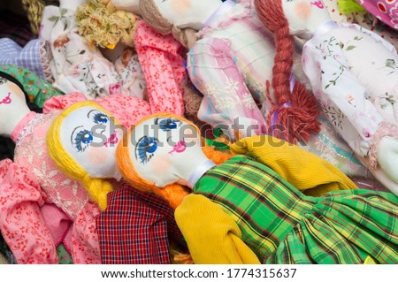 Flea market,  folk crafts. Handmade rag dolls. A rag doll is a children's toy. It is a cloth figure, a doll traditionally home-made from (and stuffed with) spare scraps of material. #1774315637