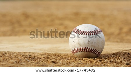 one baseball on home plate at a sports field #17743492
