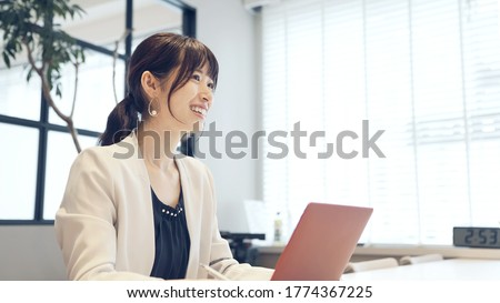Young asian businesswoman talking in the office. Royalty-Free Stock Photo #1774367225