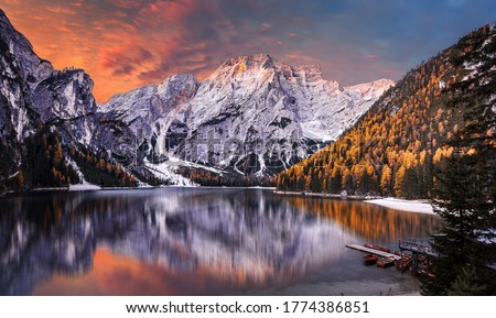 Amazing natural landscape at sunset. Stunning morning scene on the Braies Lake, Pragser Wildsee in Dolomites mountains, Italy.  Lago di Braies. Iconic location for landscape photographers