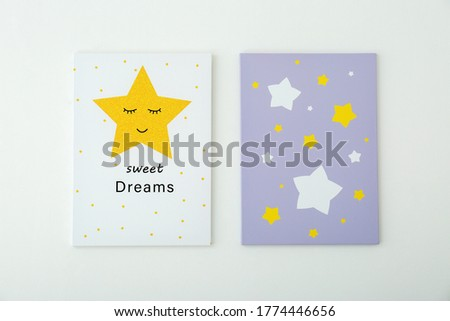 Adorable pictures of stars with words SWEET DREAMS on white wall. Children's room interior elements
