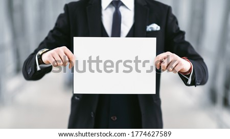 Waiting For You Concept. Empty name board in hands of meeting man in suit at airport, copy space