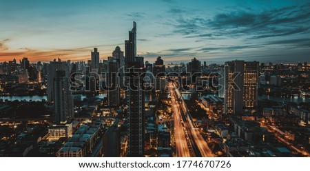 Picture of panoramic cinematic tone skyline showing downtown several prominent buildings and hotels at night.
