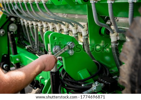 The mechanics repair combine harvester. Modern agricultural machinery Royalty-Free Stock Photo #1774696871
