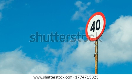 road sign speed limit on a blue sky background