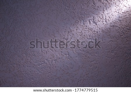 Light violet ray of light diagonally lays on a dark violet structural background #1774779515