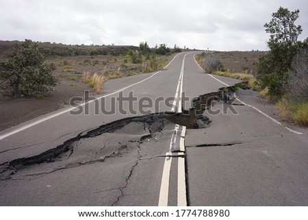 Asphalt road damaged by the volcanic eruption of Kīlauea and caldera collapse with subsequent earthquakes in Hawaii Volcanoes National Park on the Big Island. #1774788980
