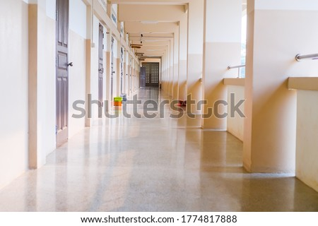 High School hallway corridor in College or university empty hall at classroom, no people student while closed quarantine in situation of Covid-19 disease outbreak result in inability organize learning Royalty-Free Stock Photo #1774817888