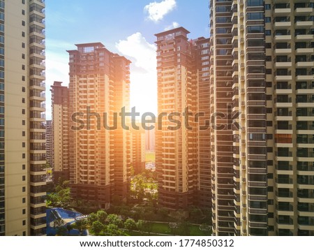 A pleasant high-rise residential building in a modern city. Royalty-Free Stock Photo #1774850312