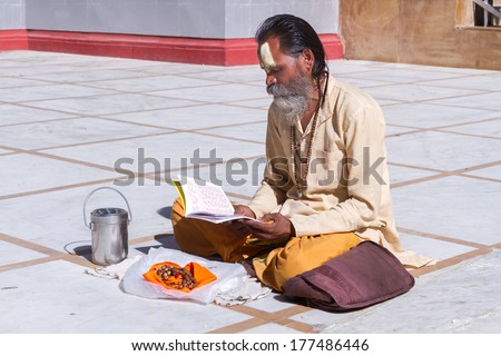 Gangotri, Uttarakhand - CIRCA May 2013 - A Hindu priest sits in the temple courtyard to read Vedic scriptures in Gangotri circa May 2013. #177486446