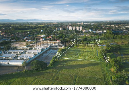 Land plot in aerial view. Include landscape, real estate, green field, agricultural plant, pin location icon. For housing subdivision, residential, development, owned, sale, rent, buy or investment. Royalty-Free Stock Photo #1774880030
