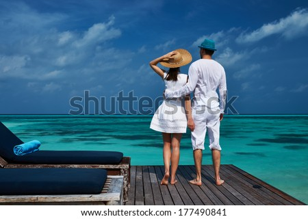 Couple on a tropical beach jetty at Maldives #177490841