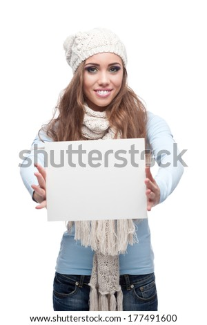 young happy smiling caucasian brunette woman in winter clothing holding sign isolated on white #177491600
