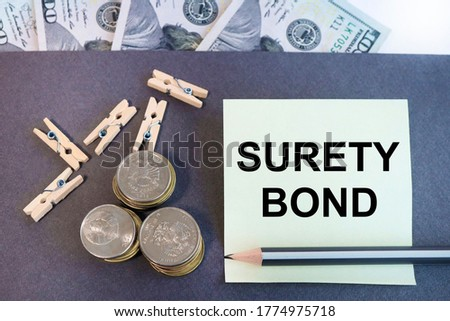 business concept .Conceptual photo Formal legally enforceable contract between three parties On a yellow sticker, on a gray background. calculator, dollar bills, pennies. caption: company performance