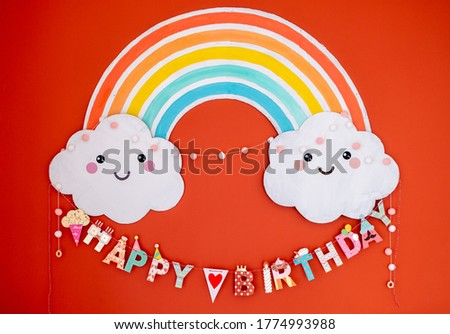 Colorful happy birthday decoration. Rainbow and clouds children birthday decoration