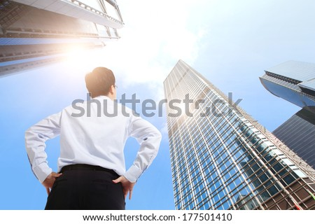 happy successful business man outdoors Next to Office Buildings with cityscape and sky, asian Royalty-Free Stock Photo #177501410