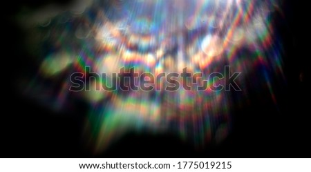 Lens flare effect on black background. Abstract Sun burst, sunflare for screen mode using. Sunflares nature abstract rainbow colourful backdrop, blinking sun burst, lens flare optical rays. #1775019215