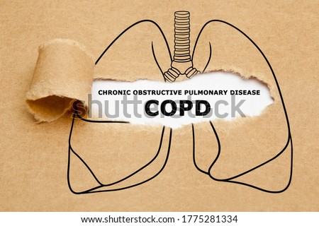 Text Chronic Obstructive Pulmonary Disease COPD appearing behind torn brown paper in human lungs drawing. Royalty-Free Stock Photo #1775281334