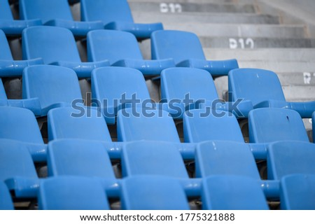 Empty soccer stadium tribune. As a safety measure during corona virus pandemic, soccer matches are taking place without public Royalty-Free Stock Photo #1775321888