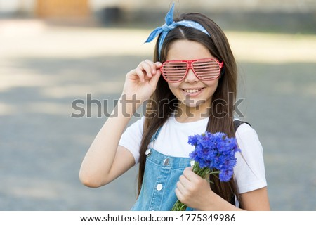 Wishing happy anniversary. Happy kid hold flowers outdoors. Fashion look of little girl. Cornflower bouquet for celebrating anniversary. Anniversary celebration. Birthday anniversary. Summer holidays. #1775349986