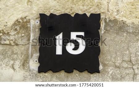 Number fifteen in door, symbol and sign, street address