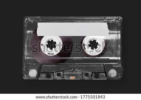 Retro old cassette on a black background.