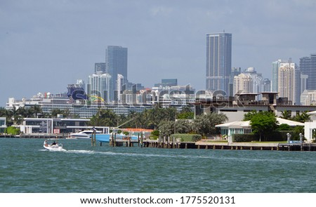 Panoramic view of RivoAlto island in Miami Beach,a coronavirus idled cruiseship in the Port of Miami and the downtown Miami tall building skyline.