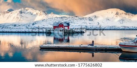 Panoramic winter view of small fishing village - Ramberg, Lofoten Islands, Norway, Europe. Dramatic morning seascape of Norwegian sea, Rambergsvika fjord. Magnificent outdoor scene over polar circle. Royalty-Free Stock Photo #1775626802