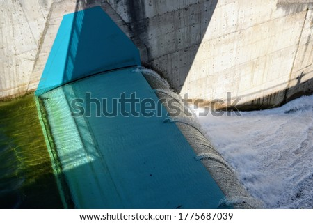 Water overflow in the dam. Opened water dam. Dam and water reservoir in Niedzica.  Czorsztyn lake, southern Poland, Europe.  #1775687039