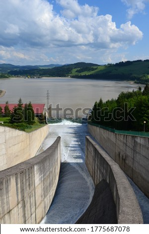 Water overflow in the dam. Opened water dam. Dam and water reservoir in Niedzica was created in order to reduce flood culminations.  Czorsztyn lake, southern Poland, Europe. .  #1775687078