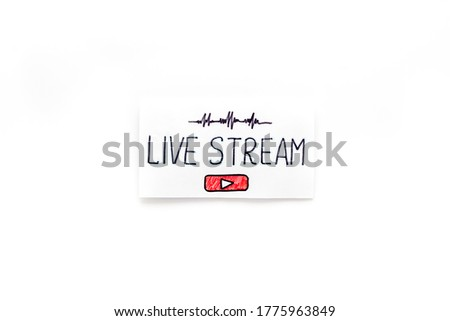 Live streaming concept - words on paper tablet on white top view