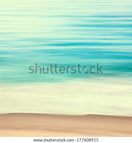 An abstract ocean seascape with blurred panning motion.  Image displays a retro look with cross-processed colors.
