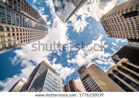 Business and finance concept, looking up at modern office building architecture in the financial district DTLA against the blue sky. Los Angeles, California, USA