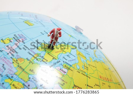 figure of Santa Claus with a globe of the World