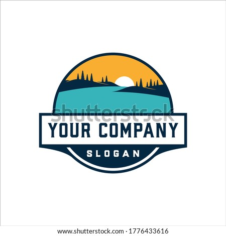 Lake and hill views with retro badge design Royalty-Free Stock Photo #1776433616