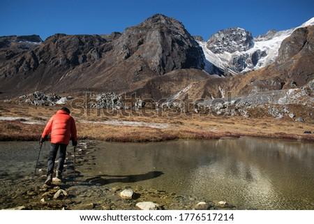 Alpine Lake in Sikkim, Goechala Trek in Sikkim, Hiking in Mountains, Crossing the Lake, Travel Inspiration Royalty-Free Stock Photo #1776517214