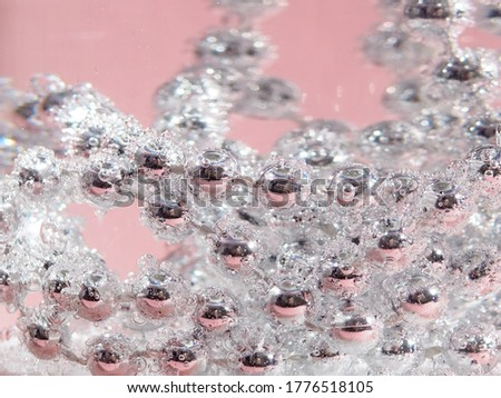 silver beads in the wine glass with water, bubbles, macro, photo, background for design #1776518105