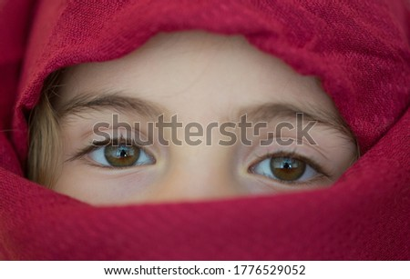 young girl with a veil covering her, close up, studio picture #1776529052