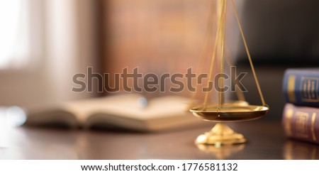 scales of justice with law books on desk of lawyer. concept of justice, legal, jurisprudence. wide view with copy space.