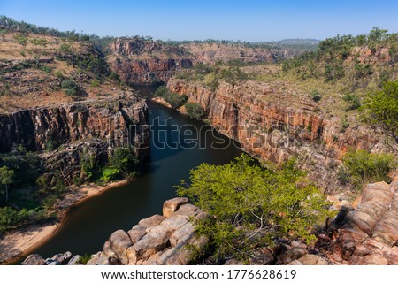Aerial view of the Katherine gorge. Katherine river turning among the escarpment walls. Aerial view, pictured from above. Nitmiluk national park, Northern Territory NT, Australia