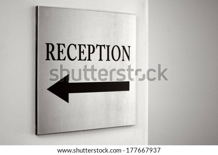 Reception sign with direction arrow. No people. Copy space