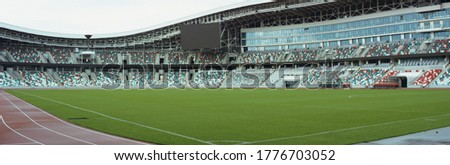 WIDE View of empty stadium seats before game or during Coronavirus COVID-19 pandemic Royalty-Free Stock Photo #1776703052