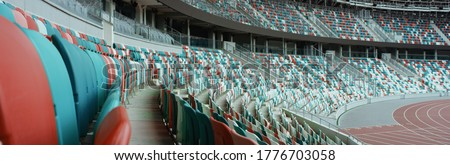 WIDE View of empty stadium seats before game or during Coronavirus COVID-19 pandemic Royalty-Free Stock Photo #1776703058