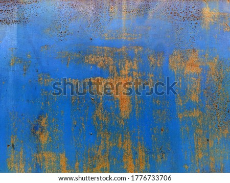 Corroded metal background. Rusted blue painted metal wall. Rusty metal background with streaks of rust. Rust stains. The metal surface rusted spots. Rystycorrosion. #1776733706