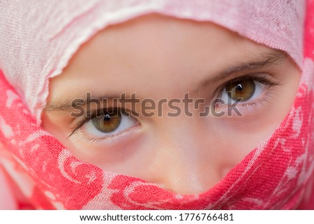 young girl with a veil covering her, close up, studio picture #1776766481