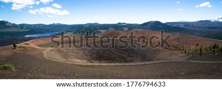 Large panorama of summit crater of Cinder Cone in Lassen Volcanic National Park in northern California. With snag lake and lassen pic with snow.