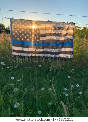Thin blue line flag at sunset Royalty-Free Stock Photo #1776871211