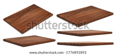 Wooden chopping Board isolated on white. Set of Cutting Boards in different angles shots in collage for your design. Wood kitchen board rectangle form. Royalty-Free Stock Photo #1776892892