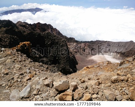 View of volcanic rock cliff and foggy on mountain at Mount Rinjani Summit Indonesia #1777109846