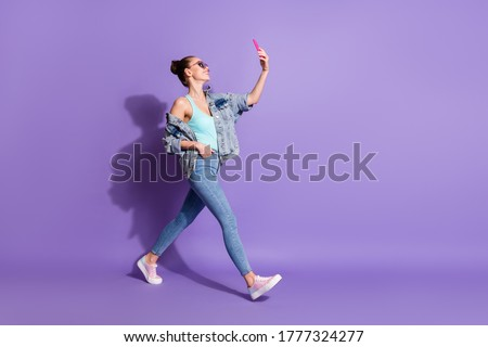 Full length body size view of her she nice attractive lovely fashionable glad cheerful girl going taking making selfie leisure isolated bright vivid shine vibrant lilac purple violet color background
